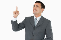 Businessman looking and pointing upwards Stock Photography