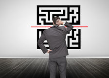 Businessman looking at qr code Royalty Free Stock Image
