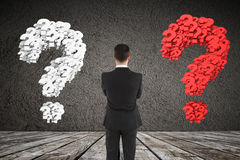 Businessman looking at question mark Royalty Free Stock Image