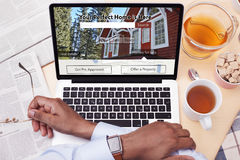 Businessman looking at a Real Estate website - Searching for a house. A Businessman looking at a Real Estate website - Searching for a house Stock Image
