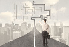 Businessman looking at road with maze and solution Royalty Free Stock Photo