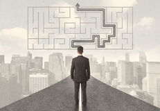 Businessman looking at road with maze and solution Stock Images
