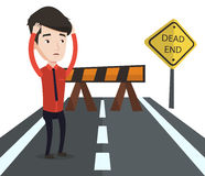 Businessman looking at road sign dead end. Stock Images