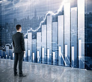 Businessman looking at the scoreboard with business chart and ci Stock Image