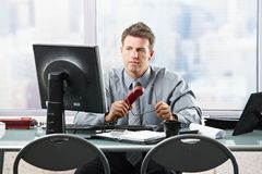 Businessman looking at screen in office Stock Images
