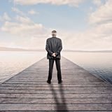 Businessman looking at the sea Royalty Free Stock Photography