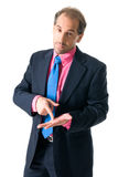 Businessman looking seriously. Businessman with pink shirt looking serious on white background royalty free stock image
