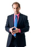Businessman looking seriously. Businessman with pink shirt looking serious on white background Stock Photo