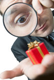 Businessman looking at a small present Royalty Free Stock Photo