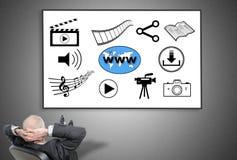 Businessman looking at social information sharing concept Royalty Free Stock Photos