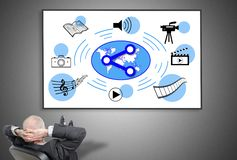 Businessman looking at social media sharing concept. Relaxed businessman looking at social media sharing concept on a whiteboard stock images