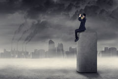 Businessman looking for a solution to pollution 1 Royalty Free Stock Images