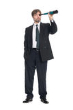 Businessman looking a spyglass Stock Photography