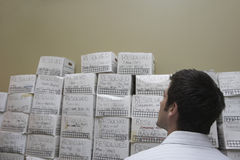 Businessman Looking At Stack Of Filing Boxes Stock Photos