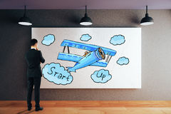 Businessman looking at start up sketch Stock Images