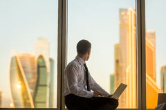 Businessman looking at sunrise Stock Image