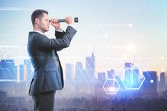 Businessman looking through a telescope Royalty Free Stock Images