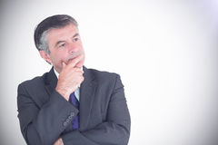 Businessman looking thoughtful Stock Image