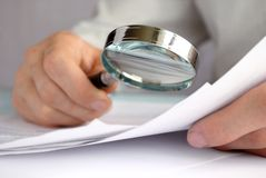 Free Businessman Looking Through A Magnifying Glass Stock Photos - 27053373
