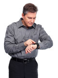 Businessman looking time at his watch. stock photo