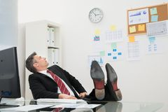 Businessman looking at time Royalty Free Stock Photos