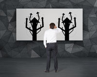Businessman looking to arrows tree Stock Photography
