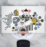 Businessman looking to business plan Stock Image