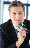 Businessman looking to the camera holding glasses Stock Photo