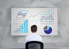 Businessman looking to chart Royalty Free Stock Image