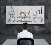 Businessman looking to chart Stock Image