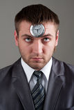 Businessman looking to clock in head Royalty Free Stock Photo