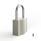 Businessman looking to 3d metal padlock Royalty Free Stock Image