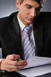 Businessman looking to documents Stock Photo