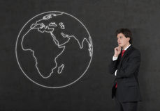 Businessman looking to drawing earth Stock Image