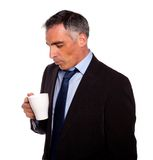 Businessman looking to a empty mug Stock Image