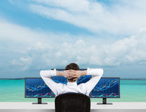 Businessman looking to forex chart. Businessman looking to monitor with forex chart on sea background Stock Photography