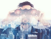 Businessman looking to the future with binoculars Royalty Free Stock Photography