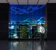Businessman looking to graphs Stock Images