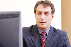 Businessman looking to monitor Royalty Free Stock Photos