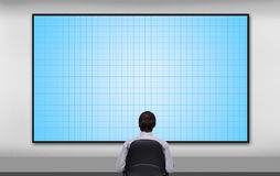 Businessman looking to plasma panel Stock Photos