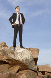 Businessman looking to the sky Stock Images