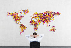 Businessman looking to world map Stock Photography