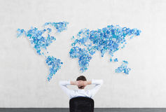 Businessman looking to world map Stock Photos