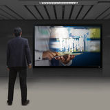 Businessman looking at TV Stock Photos