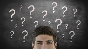 Businessman looking up. Against question marks stock footage