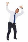 Businessman looking up with arms up Royalty Free Stock Images
