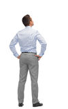 Businessman looking up from back Royalty Free Stock Images