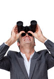 Businessman looking up through of binoculars Stock Image