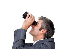 Businessman looking up through a binoculars Royalty Free Stock Photo
