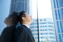 Businessman looking up at buildings Royalty Free Stock Photo